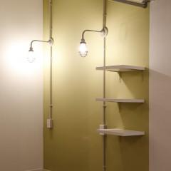 寝室の壁はライトグリーンでアクセント。